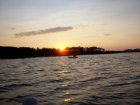 boater-on-sound-at-sunset